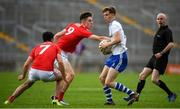 28 July 2019; Karl Gallagher of Monaghan in action against Keelan Scannell of Cork during the Electric Ireland GAA Football All-Ireland Minor Championship Quarter-Final match between Monghan and Cork at Bord Na Mona O'Connor Park in Tullamore, Offaly. Photo by David Fitzgerald/Sportsfile