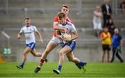 28 July 2019; Conor McKernan of Monaghan in action against Michael O'Neill of Cork during the Electric Ireland GAA Football All-Ireland Minor Championship Quarter-Final match between Monghan and Cork at Bord Na Mona O'Connor Park in Tullamore, Offaly. Photo by David Fitzgerald/Sportsfile