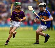 28 July 2019; Dan O'Connor, St Mary's PS, Bellanaleck, Fermanagh, representing Wexford, and Harry Mac Canainn, Scoil na nÓg, Glanmire, Cork, representing Tipperary, during the INTO Cumann na mBunscol GAA Respect Exhibition Go Games at the GAA Hurling All-Ireland Senior Championship Semi Final match between Wexford and Tipperary at Croke Park in Dublin. Photo by Ray McManus/Sportsfile