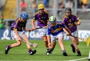 28 July 2019; Peter Boyle, St. Clares NS, Manorhamilton, Leitrim, representing Tipperary, in action against Matthew O'Neill, Carnaun NS, Athenry, Galway, representing Wexford, Ciaran King, St Kevin's NS, Dunleer, Louth, representing Wexford, and Daithí McCloskey, St Canice PS, Dungiven, Derry, representing Wexford, during the INTO Cumann na mBunscol GAA Respect Exhibition Go Games at the GAA Hurling All-Ireland Senior Championship Semi Final match between Wexford and Tipperary at Croke Park in Dublin. Photo by Brendan Moran/Sportsfile