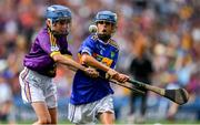 28 July 2019; Alfie Hughes, Annyalla NS, Castleblayney, Monaghan, representing Tipperary, in action against Matthew O'Neill, Carnaun NS, Athenry, Galway, representing Wexford,  during the INTO Cumann na mBunscol GAA Respect Exhibition Go Games at the GAA Hurling All-Ireland Senior Championship Semi Final match between Wexford and Tipperary at Croke Park in Dublin. Photo by Brendan Moran/Sportsfile