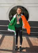 29 July 2019; Molly Mayne of Ireland with her 100m and 200m breaststroke Bronze medals on Team Ireland's return to Dublin Airport in Dublin from the 2019 Summer European Youth Olympic Festival in Baku. Photo by Harry Murphy/Sportsfile