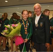 29 July 2019; Molly Mayne of Ireland with her 100m and 200m breaststroke Bronze medals and Declan Harte, President of Swim Ireland on Team Ireland's return to Dublin Airport in Dublin from the 2019 Summer European Youth Olympic Festival in Baku. Photo by Harry Murphy/Sportsfile