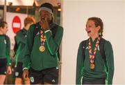 29 July 2019; Rhasidat Adeleke of Ireland with her 100m and 200m gold medals and Molly Mayne of Ireland with her 100m and 200m breaststroke Bronze medals on Team Ireland's return to Dublin Airport in Dublin from the 2019 Summer European Youth Olympic Festival in Baku. Photo by Harry Murphy/Sportsfile