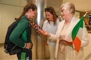 29 July 2019; Molly Mayne of Ireland has her 100m and 200m breaststroke Bronze medals inpsected by mother Laura Mayne and Grandmother Maureen Kissanne on Team Ireland's return to Dublin Airport in Dublin from the 2019 Summer European Youth Olympic Festival in Baku. Photo by Harry Murphy/Sportsfile