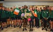 29 July 2019; Rhasidat Adeleke of Ireland with her 100m and 200m gold medals and Molly Mayne of Ireland with her 100m and 200m breaststroke Bronze medals pose for a team photo on Team Ireland's return to Dublin Airport in Dublin from the 2019 Summer European Youth Olympic Festival in Baku. Photo by Harry Murphy/Sportsfile
