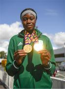 29 July 2019; Rhasidat Adeleke of Ireland with her 100m and 200m gold medals on Team Ireland's return to Dublin Airport in Dublin from the 2019 Summer European Youth Olympic Festival in Baku. Photo by Harry Murphy/Sportsfile