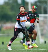 29 July 2019; Soyeon Lee of Asia Cranes in action against Suzan Lebohang Maekela of South Africa in their Ladies Football Native Born tournament game during the Renault GAA World Games 2019 Day 1 at WIT Arena, Carriganore, Co. Waterford. Photo by Piaras Ó Mídheach/Sportsfile