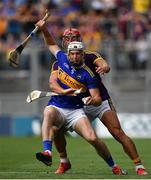 28 July 2019; Brendan Maher of Tipperary is tackled by Lee Chin of Wexford during the GAA Hurling All-Ireland Senior Championship Semi Final match between Wexford and Tipperary at Croke Park in Dublin. Photo by Brendan Moran/Sportsfile