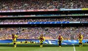 28 July 2019; RNLI volunteer lifeboat crew from stations across Ireland unfurl giant water safety flags on the pitch of Croke Park before the All-Ireland Senior Hurling semi-final match between Wexford and Tipperary at Croke Park in Dublin. The activity was part of the RNLI's partnership with the GAA to prevent drownings and share water safety advice. Photo by Ramsey Cardy/Sportsfile