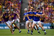 28 July 2019; Dan McCormack of Tipperary in action against Diarmuid O'Keeffe of Wexford during the GAA Hurling All-Ireland Senior Championship Semi Final match between Wexford and Tipperary at Croke Park in Dublin. Photo by Ramsey Cardy/Sportsfile