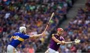 28 July 2019; Lee Chin of Wexford in action against Michael Breen of Tipperary during the GAA Hurling All-Ireland Senior Championship Semi Final match between Wexford and Tipperary at Croke Park in Dublin. Photo by Ramsey Cardy/Sportsfile