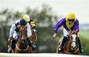 1 August 2019; Foveros, right, with Paul Townend up, races alongside eventual second place Little Nugget, left, with David Mullins up, on their way to winning the Guinness Novice Hurdle on Day Four of the Galway Races Summer Festival 2019 in Ballybrit, Galway. Photo by Seb Daly/Sportsfile