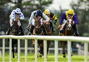 1 August 2019; Foveros, right, with Paul Townend up, races alongside eventual second place Little Nugget, second left, with David Mullins up, on their way to winning the Guinness Novice Hurdle on Day Four of the Galway Races Summer Festival 2019 in Ballybrit, Galway. Photo by Seb Daly/Sportsfile