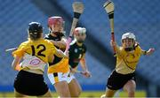 2 August 2019; Lisa Loughnane of Australasia in action against Emma Carroll, left, and Eimear Clarke of Middle East in the Renault GAA World Games Camogie Irish Cup Final during the Renault GAA World Games 2019 Day 5 - Cup Finals at Croke Park in Dublin. Photo by Piaras Ó Mídheach/Sportsfile