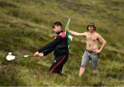 3 August 2019; Robert O'Donnell, from Pallasgreen, supporting Colin Ryan of Limerick, left, during the 2019 M. Donnelly GAA All-Ireland Poc Fada Finals at Annaverna Mountain in the Cooley Peninsula, Ravensdale, Co Louth. Photo by Piaras Ó Mídheach/Sportsfile