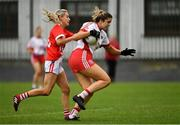 3 August 2019; Aoibhinn McHugh of Tyrone in action against Orla Finn of Cork during the TG4 All-Ireland Ladies Football Senior Championship Quarter-Final match between Cork and Tyrone at Duggan Park in Ballinasloe, Galway. Photo by Ray McManus/Sportsfile