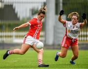 3 August 2019; Doireannn O'Sullivan of Cork shoots past Tori McLaughlin of Tyrone to score her side's 4th goal during the TG4 All-Ireland Ladies Football Senior Championship Quarter-Final match between Cork and Tyrone at Duggan Park in Ballinasloe, Galway. Photo by Ray McManus/Sportsfile