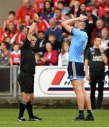 3 August 2019; Referee Derek O'Mahoney shows a black card to Peadar O Cofaigh Byrne of Dublin during the EirGrid GAA Football All-Ireland U20 Championship Final match between Cork and Dublin at O'Moore Park in Portlaoise, Laois. Photo by Matt Browne/Sportsfile