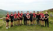 3 August 2019; Winner Cillian Kiely, centre, with Tom Ryan, Cathaoirleach, National Poc Fada Committee, left, and Poc Fada sponsor Martin Donnelly, right, with, from left, Paddy McKillian, Callum Quirke, Darren Geoghegan, Gareth Johnson, Cathal Kiely, Cillian Kiely, Ronan Taafe, Sean Nugent, Tadhg Haran and Ulster GAA Secretary Brian McAvoy following the 2019 M. Donnelly GAA All-Ireland Poc Fada Finals at Annaverna Mountain in the Cooley Peninsula, Ravensdale, Co Louth. Photo by David Fitzgerald/Sportsfile