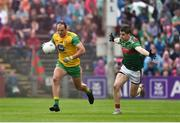 3 August 2019; Michael Murphy of Donegal in action against Lee Keegan of Mayo during the GAA Football All-Ireland Senior Championship Quarter-Final Group 1 Phase 3 match between Mayo and Donegal at Elvery's MacHale Park in Castlebar, Mayo. Photo by Daire Brennan/Sportsfile