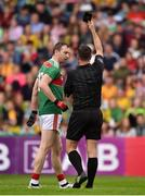 3 August 2019; Keith Higgins of Mayo receives a black card from referee David Gough during the GAA Football All-Ireland Senior Championship Quarter-Final Group 1 Phase 3 match between Mayo and Donegal at Elvery's MacHale Park in Castlebar, Mayo. Photo by Daire Brennan/Sportsfile
