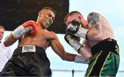 3 August 2019; Paddy Barnes, right, in action against Joel Sanchez during their bantamweight bout at Falls Park in Belfast. Photo by Ramsey Cardy/Sportsfile