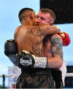 3 August 2019; Paddy Barnes, right, and Joel Sanchez embrace following their bantamweight bout at Falls Park in Belfast. Photo by Ramsey Cardy/Sportsfile