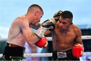 3 August 2019; Paddy Barnes, left, in action against Joel Sanchez during their bantamweight bout at Falls Park in Belfast. Photo by Ramsey Cardy/Sportsfile