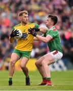 3 August 2019; Stephen McMenamin of Donegal in action against Cillian O'Connor of Mayo during the GAA Football All-Ireland Senior Championship Quarter-Final Group 1 Phase 3 match between Mayo and Donegal at Elvery's MacHale Park in Castlebar, Mayo. Photo by Daire Brennan/Sportsfile