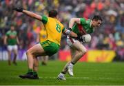 3 August 2019; Patrick Durcan of Mayo is tackled by Hugh McFadden of Donegal during the GAA Football All-Ireland Senior Championship Quarter-Final Group 1 Phase 3 match between Mayo and Donegal at Elvery's MacHale Park in Castlebar, Mayo. Photo by Brendan Moran/Sportsfile