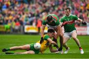 3 August 2019; Michael Langan of Donegal is tackled by Aidan O'Shea and Colm Boyle of Mayo during the GAA Football All-Ireland Senior Championship Quarter-Final Group 1 Phase 3 match between Mayo and Donegal at Elvery's MacHale Park in Castlebar, Mayo. Photo by Brendan Moran/Sportsfile