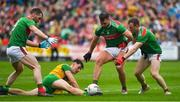 3 August 2019; Michael Langan of Donegal is tackled by Seamus O'Shea, Aidan O'Shea and Colm Boyle of Mayo during the GAA Football All-Ireland Senior Championship Quarter-Final Group 1 Phase 3 match between Mayo and Donegal at Elvery's MacHale Park in Castlebar, Mayo. Photo by Brendan Moran/Sportsfile
