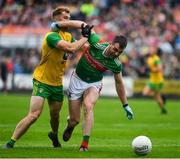 3 August 2019; Seamus O'Shea of Mayo is tackled by Stephen McMenamin of Donegal during the GAA Football All-Ireland Senior Championship Quarter-Final Group 1 Phase 3 match between Mayo and Donegal at Elvery's MacHale Park in Castlebar, Mayo. Photo by Brendan Moran/Sportsfile