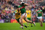 3 August 2019; Aidan O'Shea of Mayo in action against Niall O'Donnell of Donegal during the GAA Football All-Ireland Senior Championship Quarter-Final Group 1 Phase 3 match between Mayo and Donegal at Elvery's MacHale Park in Castlebar, Mayo. Photo by Brendan Moran/Sportsfile