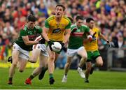 3 August 2019; Hugh McFadden of Donegal is tackled by Eoin O'Donoghue of Mayo during the GAA Football All-Ireland Senior Championship Quarter-Final Group 1 Phase 3 match between Mayo and Donegal at Elvery's MacHale Park in Castlebar, Mayo. Photo by Brendan Moran/Sportsfile