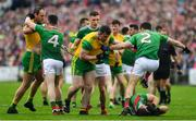 3 August 2019; Michael Murphy, left, and Patrick McBrearty of Donegal get involved with Eoin O'Donoghue and Chris Barrett of Mayo as Aidan O'Shea of Mayo lies injured during the GAA Football All-Ireland Senior Championship Quarter-Final Group 1 Phase 3 match between Mayo and Donegal at Elvery's MacHale Park in Castlebar, Mayo. Photo by Brendan Moran/Sportsfile