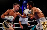 3 August 2019; Michael Conlan, left, in action against Diego Alberto Ruiz during their WBA and WBO Inter-Continental Featherweight title bout at Falls Park in Belfast. Photo by Ramsey Cardy/Sportsfile