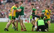3 August 2019; Fionn McDonagh of Mayo restrains Patrick McBrearty of Donegal as Aidan O'Shea of Mayo lies injured during the GAA Football All-Ireland Senior Championship Quarter-Final Group 1 Phase 3 match between Mayo and Donegal at Elvery's MacHale Park in Castlebar, Mayo. Photo by Brendan Moran/Sportsfile