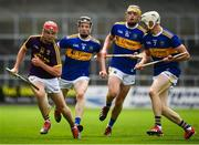 4 August 2019; Conall Clancy of Wexford in action against Tipperary players, from left, Jerome Cahill, Conor Bowe and Bryan O'Mara during the Bord Gáis GAA Hurling All-Ireland U20 Championship Semi-Final match between Tipperary and Wexford at Nowlan Park in Kilkenny. Photo by David Fitzgerald/Sportsfile