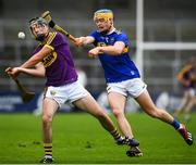 4 August 2019; Conor Scallan of Wexford in action against Conor Bowe of Tipperary during the Bord Gáis GAA Hurling All-Ireland U20 Championship Semi-Final match between Tipperary and Wexford at Nowlan Park in Kilkenny. Photo by David Fitzgerald/Sportsfile