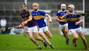 4 August 2019; Conor Scallan of Wexford in action against Bryan O'Mara, right, and Conor Bowe of Tipperary during the Bord Gáis GAA Hurling All-Ireland U20 Championship Semi-Final match between Tipperary and Wexford at Nowlan Park in Kilkenny. Photo by David Fitzgerald/Sportsfile