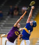 4 August 2019; Billy Seymour of Tipperary in action against Eoin O'Leary of Wexford during the Bord Gáis GAA Hurling All-Ireland U20 Championship Semi-Final match between Tipperary and Wexford at Nowlan Park in Kilkenny. Photo by David Fitzgerald/Sportsfile