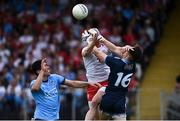 4 August 2019; Richard Donnelly of Tyrone in action against Evan Comerford and Rory O'Carroll of Dublin during the GAA Football All-Ireland Senior Championship Quarter-Final Group 2 Phase 3 match between Tyrone and Dublin at Healy Park in Omagh, Tyrone. Photo by Oliver McVeigh/Sportsfile