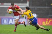 4 August 2019; Ian Maguire of Cork in action against Colin Compton of Roscommon during the GAA Football All-Ireland Senior Championship Quarter-Final Group 2 Phase 3 match between Cork and Roscommon at Páirc Uí Rinn in Cork. Photo by Matt Browne/Sportsfile