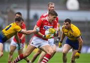 4 August 2019; Ian Maguire of Cork in action against Aengus Lyons and Fintan Cregg of Roscommon during the GAA Football All-Ireland Senior Championship Quarter-Final Group 2 Phase 3 match between Cork and Roscommon at Páirc Uí Rinn in Cork. Photo by Matt Browne/Sportsfile
