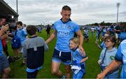 4 August 2019; Eoghan O'Gara of Dublin leaves the pitch with his daughter Ella after the GAA Football All-Ireland Senior Championship Quarter-Final Group 2 Phase 3 match between Tyrone and Dublin at Healy Park in Omagh, Tyrone. Photo by Brendan Moran/Sportsfile
