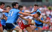 4 August 2019; Michael McKernan of Tyrone is tackled by Eoin Murchan, Michael Darragh MacAuley and Robert McDaid of Dublin during the GAA Football All-Ireland Senior Championship Quarter-Final Group 2 Phase 3 match between Tyrone and Dublin at Healy Park in Omagh, Tyrone. Photo by Brendan Moran/Sportsfile
