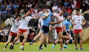 4 August 2019; Diarmuid Connolly of Dublin in action against Tyrone players, from left, Michael McKernan, Darren McCurry, Rory Brennan, Ben McDonnell and David Mulgrew during the GAA Football All-Ireland Senior Championship Quarter-Final Group 2 Phase 3 match between Tyrone and Dublin at Healy Park in Omagh, Tyrone. Photo by Oliver McVeigh/Sportsfile