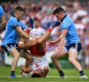 4 August 2019; Michael McKernan of Tyrone is tackled by Cian O'Connor, left, and Robert McDaid of Dublin during the GAA Football All-Ireland Senior Championship Quarter-Final Group 2 Phase 3 match between Tyrone and Dublin at Healy Park in Omagh, Tyrone. Photo by Brendan Moran/Sportsfile
